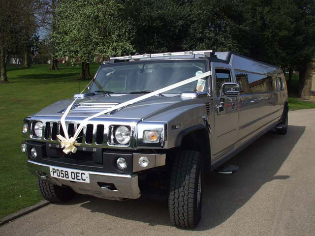 Silver limo for wedding travel