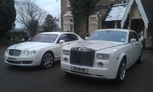 Manns Limousines Two models White Rolls Royce