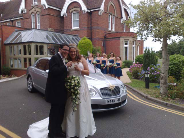 Happy Bride and Groom with their prestige wedding car hire West Midlands