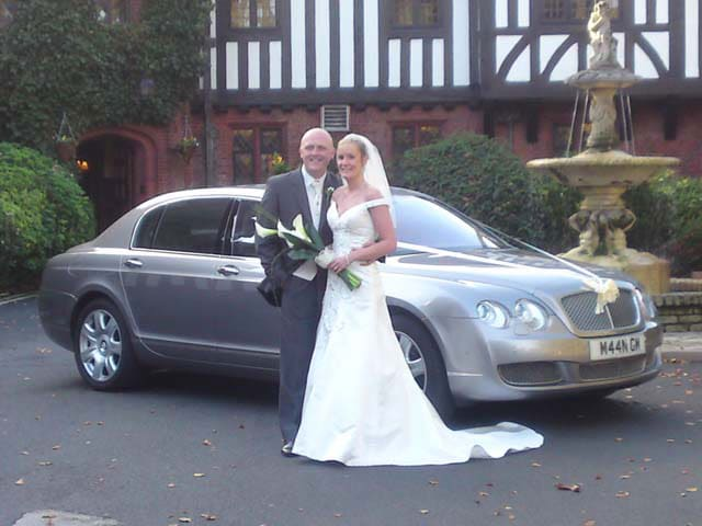 chauffeur driven Silver Bentley Continental