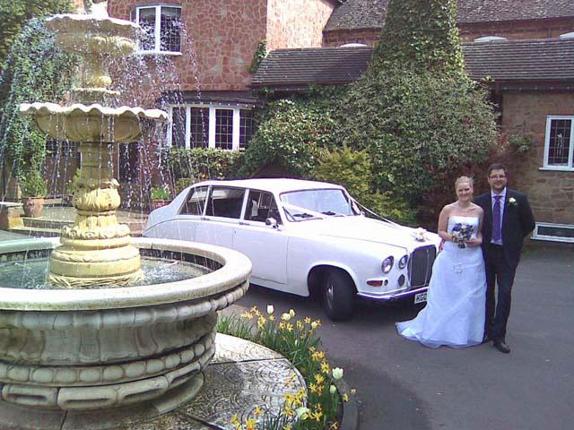 Old white wedding car for prestige wedding car hire West Midlands