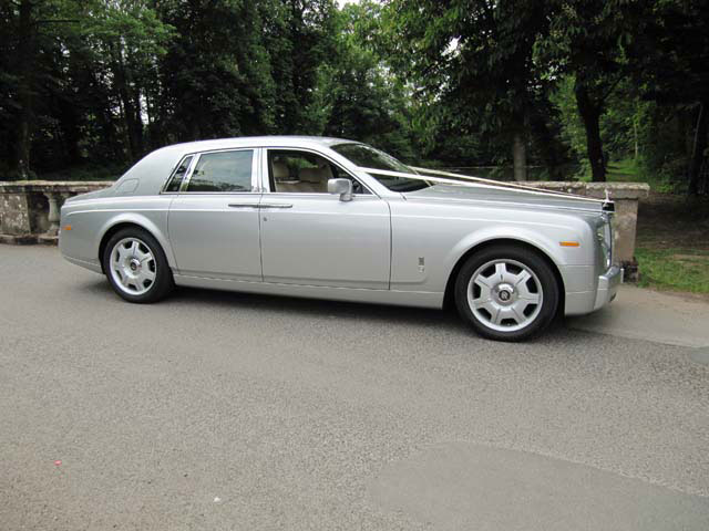 Side view silver Rolls Royce hire