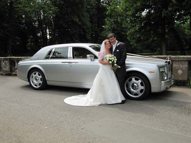 Bride and groom Silver Rolls Royce for prestige wedding car hire West Midlands