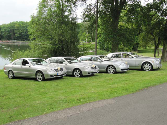 Four Silver Rolls Royce cars for weddings