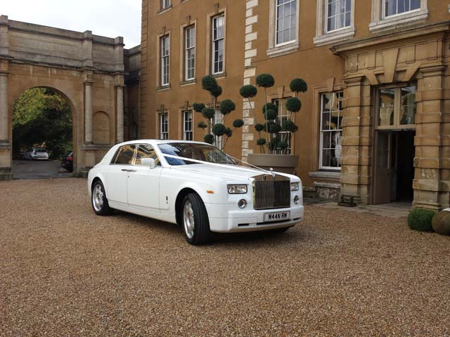 White Rolls Royce outside wedding venue
