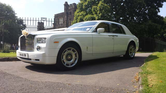 Side view of white Rolls Royce wedding car hire