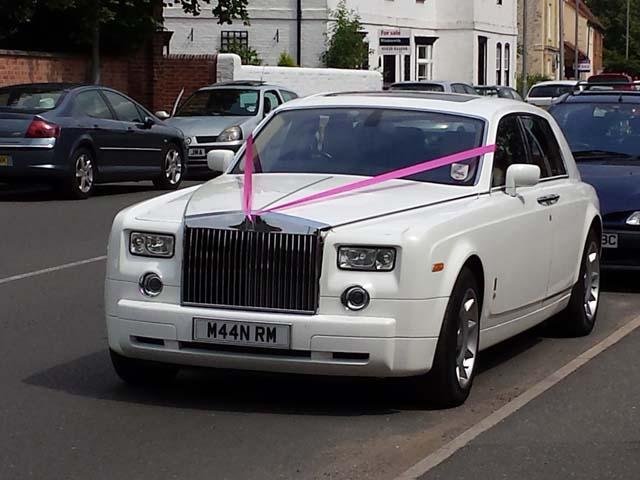 White Rolls Royce Pink Ribbon for prestige wedding car hire West Midlands