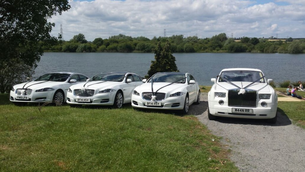 white chauffeur driven wedding cars
