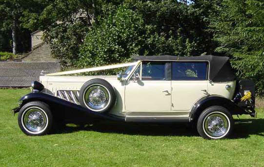 Ivory & Black Beauford Tourer with Black Hood Side View