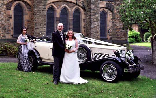 Ivory & Black Beauford Tourer with Black Hood Manns Limousines