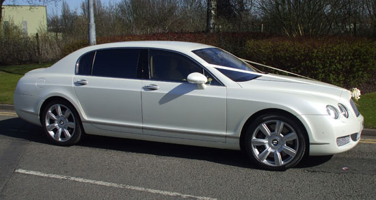 White Bentley Continental Flying Spur Manns Limo