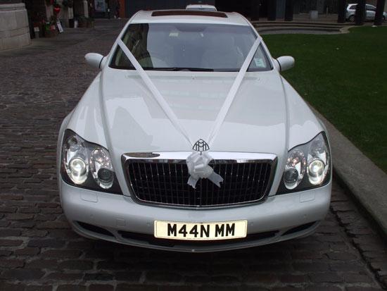 Manns Limo White Maybach with White Ribbon for prestige wedding cars
