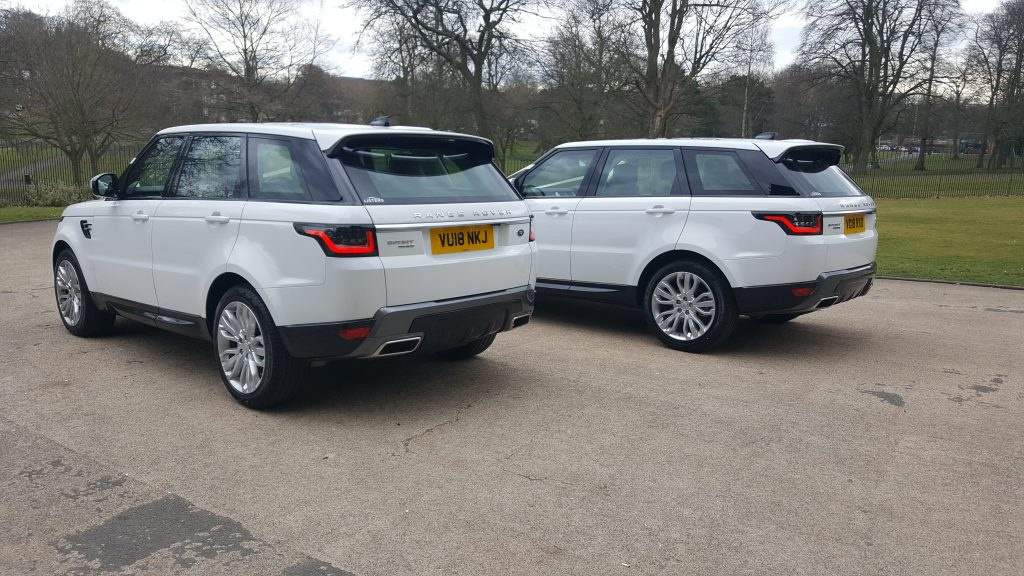matching white Range Rovers