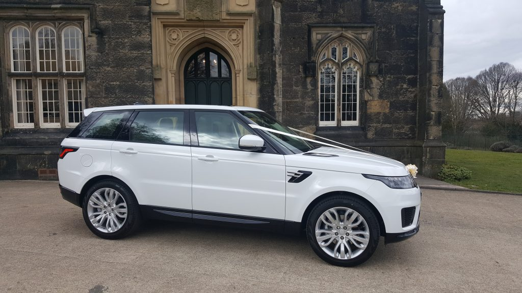 Latest wedding day vehicle White Range Rover
