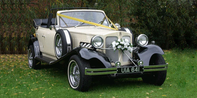 Manns Limo Ivory & Black Beauford Tourer with Black Hood vintage car hire